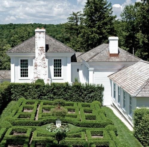 I could live here! Robert Couturier built this neo- classic Pavilion Home with beautiful boxwood parteress.