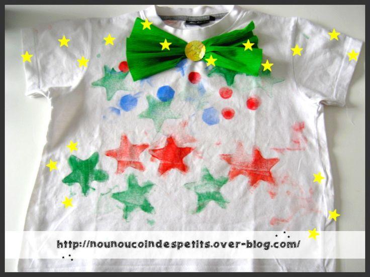 - pour accompagner le chapeau du clown , un de mes loulous 15 mois ( loulou 2 est au ski et en vacance pendant 2 semaines ) , a peint a l'éponge étoile un vieux tee-shirt blanc de mon fils , nounou y a ajouté un noeud en papier crépon ... - peinture grosse...