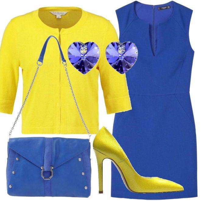 Un vivace blu elettrico contraddistingue il tubino senza maniche, da indossare con un cardigan giallo, come gialle sono le scarpe décolleté con tacco alto. La borsa a tracolla richiama il colore del vestito e ha fibia e decori in metallo; cuori in cristallo impreziosiscono gli orecchini e il ciondolo della collana.
