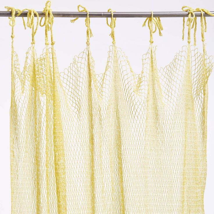 Exclusively at ABC, one of a kind designs are hand-knotted by fishermen's wives in Haiphong Port, Vietnam. Inspired by traditional fishing nets, ancestral patterns are reimagined in gauzy cotton, reinvented as works of art. Adorn windows and doorways or use as a room divider or shower curtain overlay.