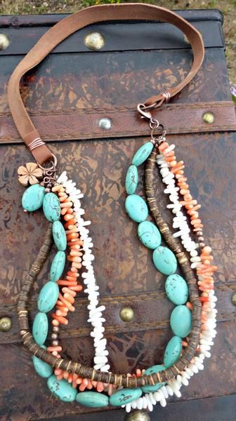 Coral, wood, stone and copper metal with leather necklace. Necklace is 23 inches long and can be altered to any length with notes to seller in checkout. Thank you for shopping hand made and Thanks for