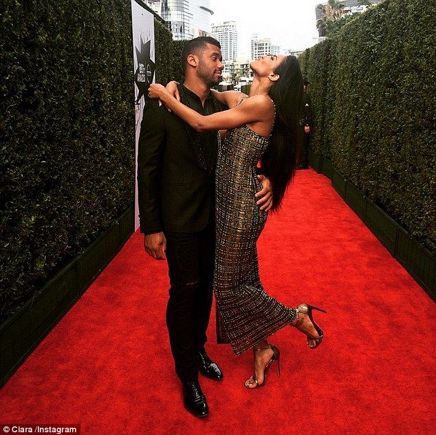 'Take me away.....': Ciara shared this loved up Instagram of she and Russell on Sunday...