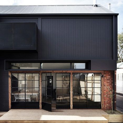 Recycled bricks, corrugated cladding and oak flooring were used to build this barn-inspired extension to a house in Melbourne by Whiting Architects.