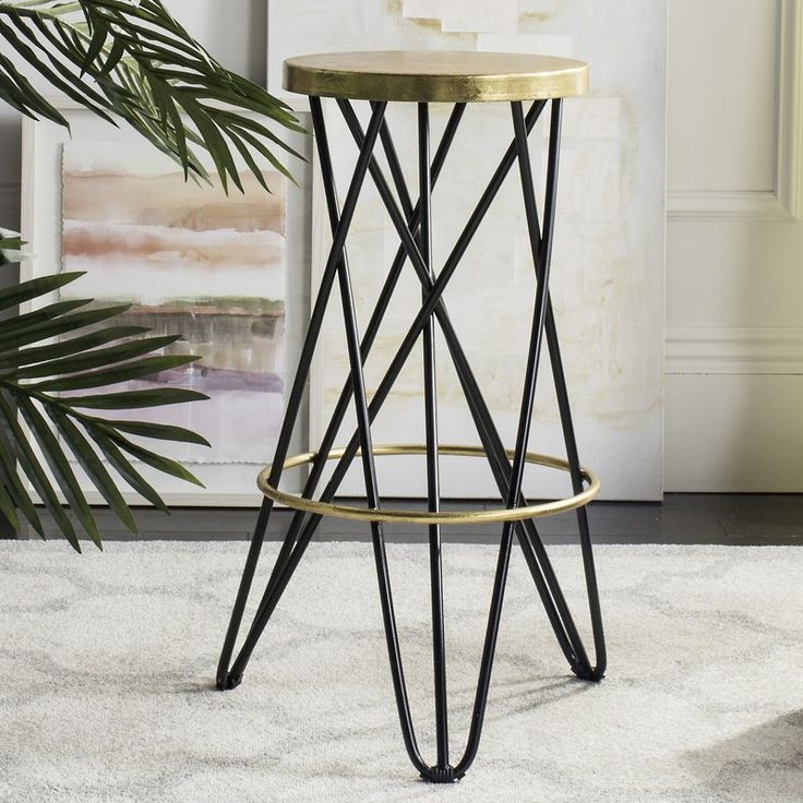 This Bar Stool brings a trendy decor style to the kitchen or dinette island. With a design straight from a Mediterranean cafe, its seductive look adds a vibrant charm with gold leaf trim and shapely, hairpin legs.