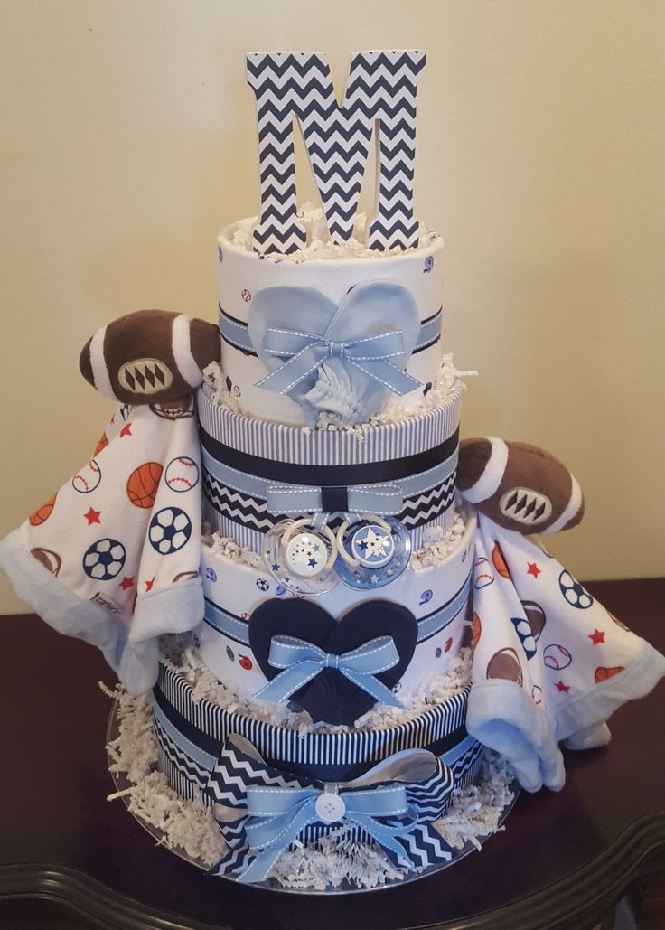 Twin boys baby shower! Football/sports navy and blue diaper cake. Check out my Facebook page Simply Showers for more pics and orders.  Created by Kim Swinson