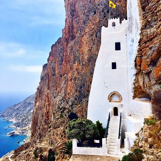 The unique Monastery of Hozoviotissa in Amorgos island ( Αμοργός ) . It is 300m high above the level of the sea and it's accessible only by walk , but you will never regret it !  A beautiful combination , the great history with the white & blue of the Aegean sea . Looks like one with the nature .