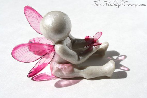 This tender hand sculpted angel baby is sending off a butterfly with a special message for family. Take flight and soar and on your way please