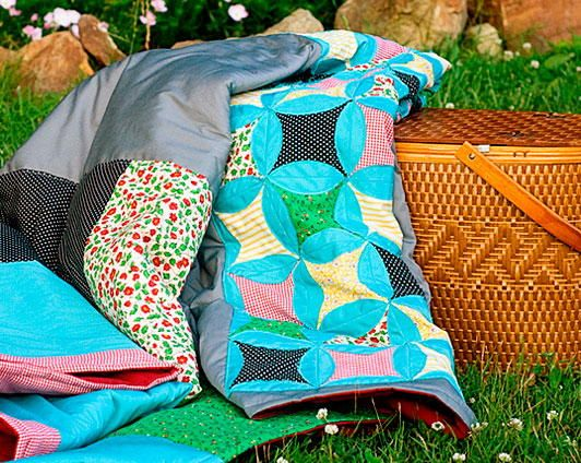 Church Picnic Quilt - Enjoy a pleasant outing with the family with the stellar Church Picnic Quilt. This gorgeous cathedral window quilt pattern comes alive with colorful quilt fabric, but still maintains the appeal of vintage quilt patterns. Few quilts with summer theme designs are as incredible as this, so don't hesitate to give it a try. It's big enough for the whole family to enjoy on a picnic, and it's beautiful enough for you to keep around the house as well.