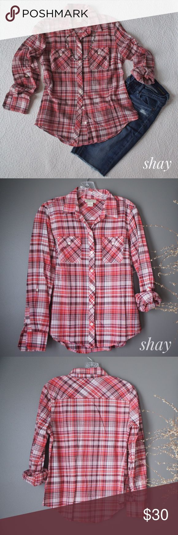 Fitted Plaid Woven It really pays to hang dry your clothes. This red plaid woven from Lucky Brand looks as good as the day it was bought! It has a very flattering fitted look. The sleeves also roll and button for a choice in length. A nice, lighter weight shirt that will bring you through most of the year. Lucky Brand Tops Button Down Shirts