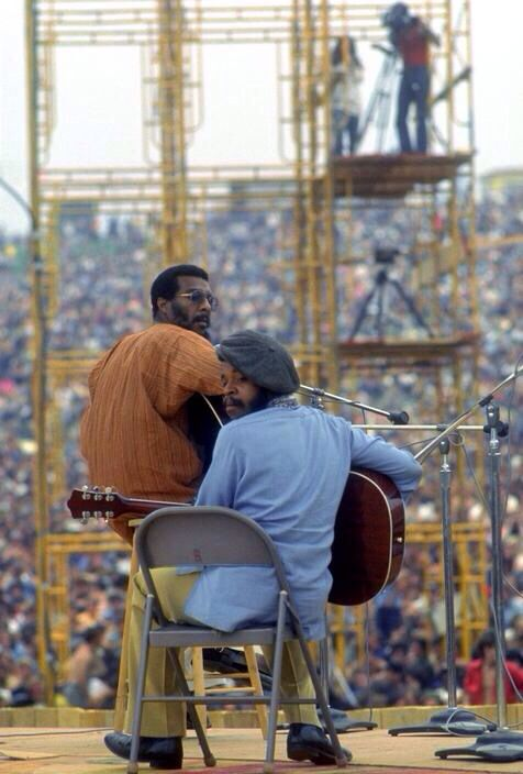 Richie Havens with his second ....... guitarist and sometime congo player Daniel Ben Zebulon performing first in front of a crowd of more than 300,000.