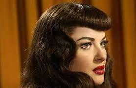 Risultati immagini per acconciature anni 60 capelli ricci