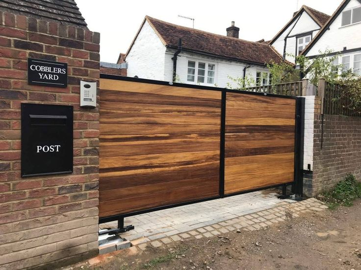 Lovely Electric gates fitted with BFT underground motors Special brackets were fabricated as driveway sloped up