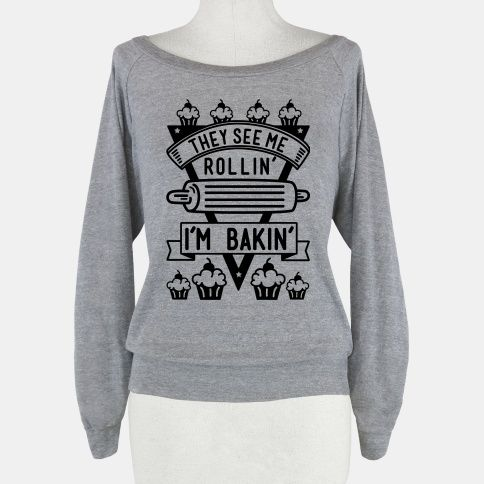 """Show your love for the culinary art of baking with this cute cupcake shirt. This graphic tee features an illustration of a rolling pin, cupcakes, and the phrase """"They See Me Rollin I'm Bakin.""""... 