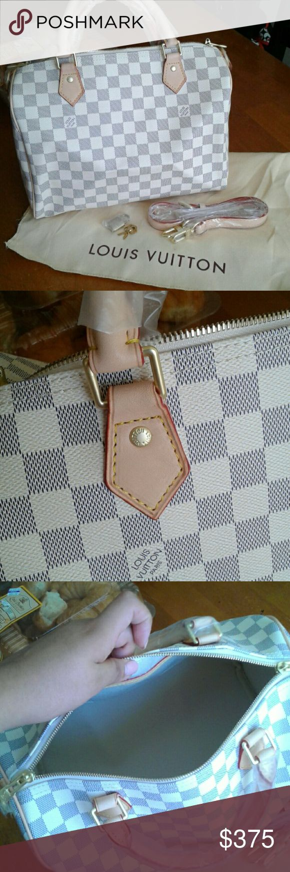 """AZUR SPEEDY BANDOULIERE 💋BRAND NEW GENIUNE LEATHER SPEEDY B. SIZE 30.INCLUDES STRAP, LOCK ,2 KEYS AND DUSTBAG! 💋MADE FROM VACHETTA LEATHER, THAT WILL PATINA BEAUTIFULLY OVER TIME, 1:1 MIRROR REPLICA 💋MADE TO LOOK LIKE THE REAL DEAL, SAME CRAFTMANSHIP AND MATERIALS, WELL MADE!  💓GET THE LOOK WITH OUT PAYING THE PRICE.                                         ❎UNBRANDED❎ ❌THIS IS A FAUX LV PURSE, MEANING NO.N-AU.T.H, PLEASE DO NOT ASK, AS I AM CLEARLY STATING """"NO IT IS NOT!!❌…"""