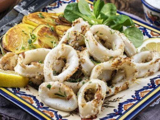 Calamari marinati in olio d oliva