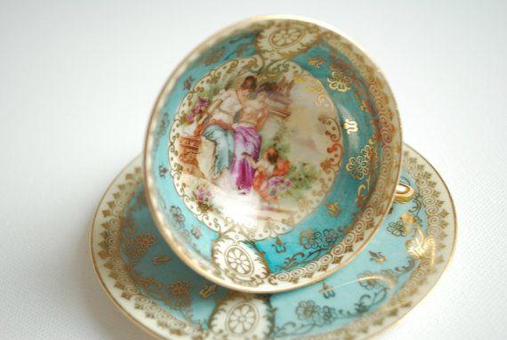 German aqua scenic tea cup.