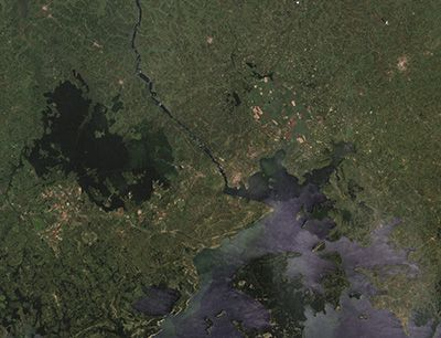 Aerial view of Lake Victoria -  The largest of the African Great Lakes, Victoria is situated across Tanzania, Uganda, and Kenya. Radar Technologies International's (RTI) WATEX System uses Landsat data, which contains information on surface topography and rock chemistry, to help locate underground water.
