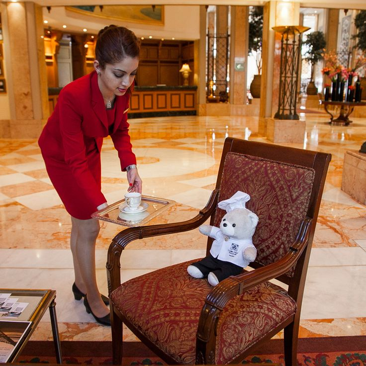 """""""After a long journey the front desk attendant, 'Lady in Red', helps Teddy with jet check-in! Of course a cup of Turkish coffee never hurts… #ChefTeddy"""