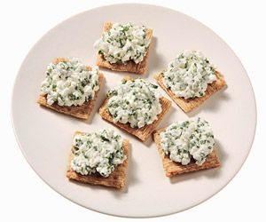 150 calorie snack - 1/4 cup low-fat cottage cheese, 1 tablespoons fresh chopped chives, 6 whole-grain crackers