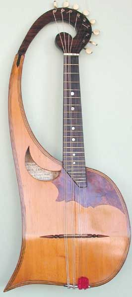 LYRE MANDOLIN beautiful classical stringed instrument with two wood tones and glossy finish - http://www.pinterest.com/DianaDeeOsborne/instruments-for-joy -These get their names from their similar strings to harps; this one looks like the grandfather of a guitar  -DdO:) - Pin via mahlerfangirl