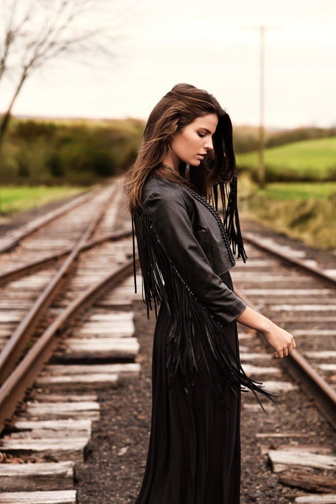 [Cameron Russell is Western Chic for H&M Shoot by David Roemer- fringe jacket and black dress]