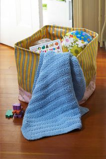 Seed stitch stripes add great texture to this baby blanket. (Lion Brand Yarn)