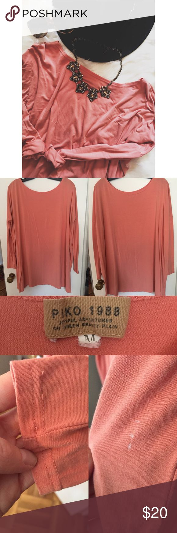 """Piko Just Peachy Slouchy Dress Lovely Piko Slouchy tee dress! Personally, it is not long enough for me to wear as a dress (I am 5'8""""), but I wore it was a long tunic with jeans and leggings. So cute! Pre-loved, so it does have to wear and tear. There are stitches popped on one sleeve and a bleach spot (see photos). Otherwise, it is in good condition. Purchased from a boutique in Springfield, MO called Staxx (the last photo is their ad). So adorable! Piko 1988 Dresses Mini"""