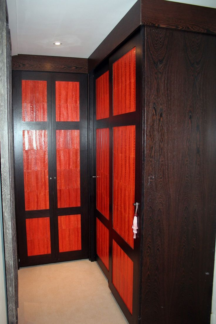Wenge timber wardrobe with stained leather centre panels