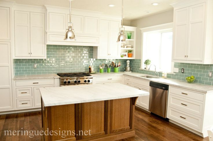 Kitchen with white cabinets, wood floors, green tile, marble counters. I'd do a farmhouse sink.