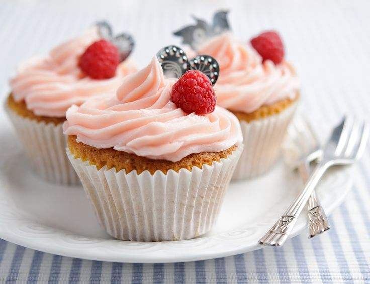 Raspberry filled cupcakes topped with pretty pink frosting - the perfect present for a special someone.