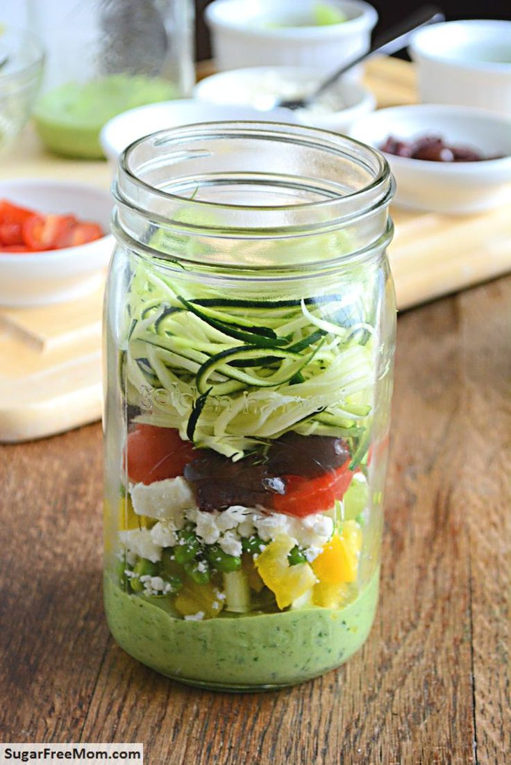 Zucchini Pasta Salad with Avocado Spinach dressing is a creamy luscious raw vegetable salad served in an easy mason jar to go!
