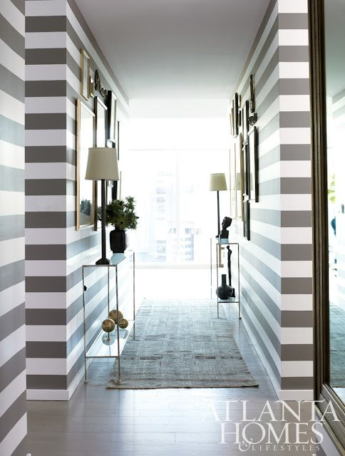 striped entry/hallway. like the staggered placement of the accent tables.