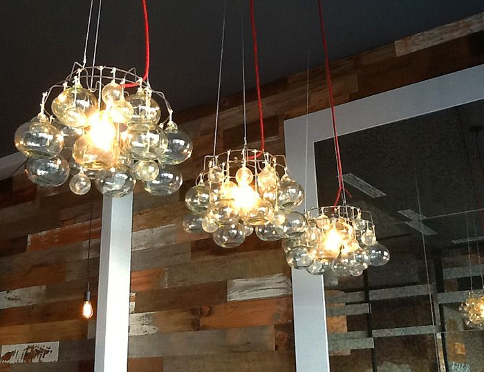 Chandeliers made from vintage canning racks handblown glass balls custom lighting made by joy price for new hobnob restaurant in naples florida