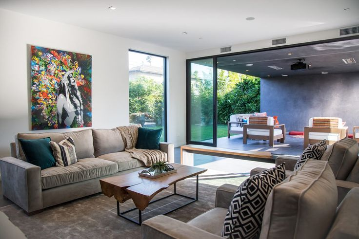 modern living room that open up to the outdoor space