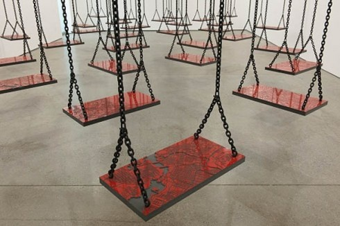 Mona Hatoum. Much of her art explores cultural displacement and exile. In her installation titled Suspended, a room full of swings initially evokes a playful atmosphere but, upon closer inspection, Hatoum has placed a randomly chosen map on each swing, representing the precariousness of war and randomness of its victims.