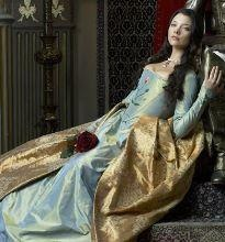Anne Boleyn. I adore the tudors and ALL of her clothes. If I lived back then I'd wear them