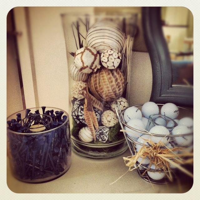 Golf decor - bowl/basket tied with raffia - would look great on the burlap table center