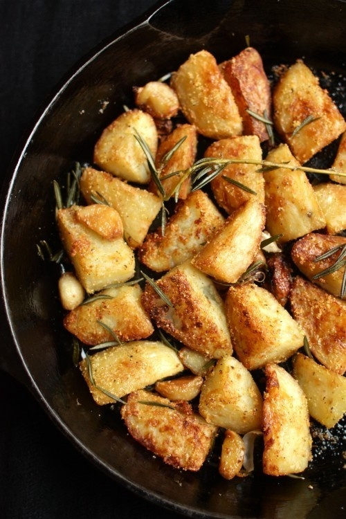 Roast Potatoes Two Ways: Polenta-Crusted and Rosemary Hash Browns     When I went all veggie awhile back, the toughest part was diversity in cooking.  Lots of different things to do with chicken, but what about flavorful---and healthy---vegetables?  The old potato, despite a very high glycemic index, is versatile.  I limit the quantity I eat on a weekly basis, but when I indulge in the popular root, I savor each bite of this recipe.  You will, too, whether omnivore or veggievore. great