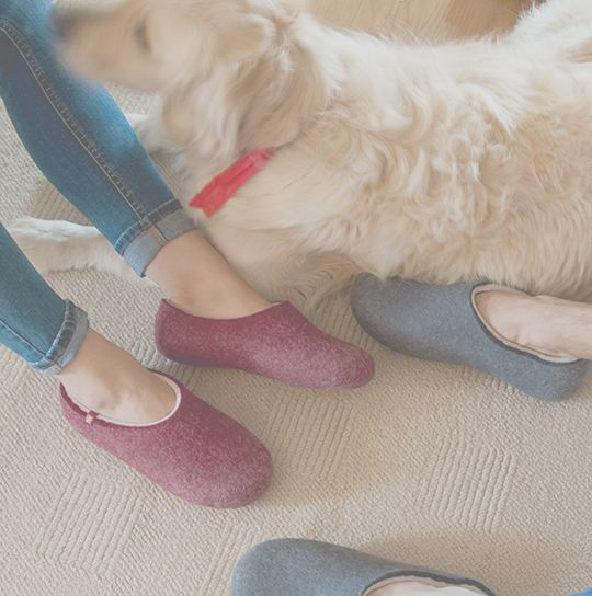 Man and woman wearing BLISS wooppers #felted #slippers