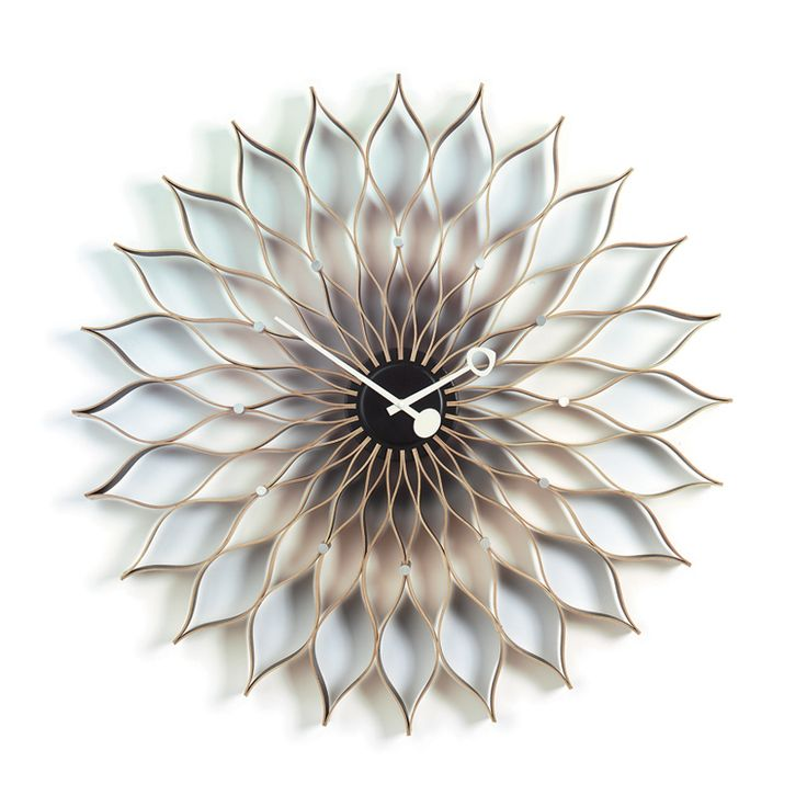 VITRA Horloge SUNFLOWER CLOCK disponible chez Silvera-Eshop, sp�cialiste du mobilier design.