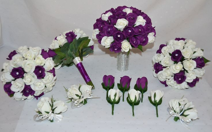 Soft feel rose buds in purple and white with a sparkling diamante to the centre of every single rose. Silver dimpled diamante stem wrap for the bride tops it off perfectly! #justfakeitbouquets #rosebouquet #purplewedding #artificialflowers