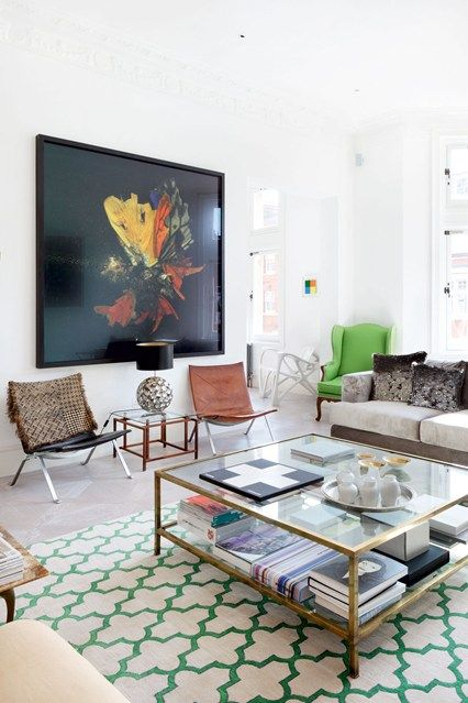 Designer Fiona Parke and owner Bodil Blain opted for a statement rug from The Rug Company in the sitting room of Bodil's Bayswater flat. Set against the neutral backdrop of the walls are Mat Collishaw's Insecticide 13 print. 'Bone' chair by Joris Laarman and sofa by Francis Sultana. (houseandgarden.co.uk)