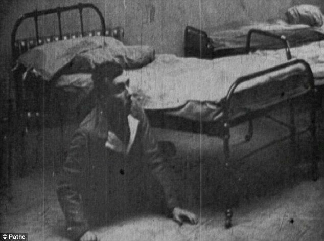 Terrified: Private Preston, aged 19, had amnesia, word blindness and word deafness except to the word 'Bombs!'. Here Preston is emerging from underneath the bed after cowering underneath it. Poor kid