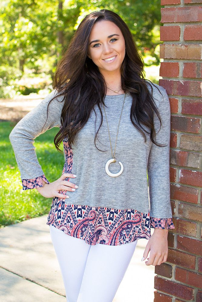 Ohana means family, so it's only natural you accept this G O R G E O U S gray top by THML into yours! We are slightly obsessed with the contrasting boho print on the hem, sides, and on the cuffs of th