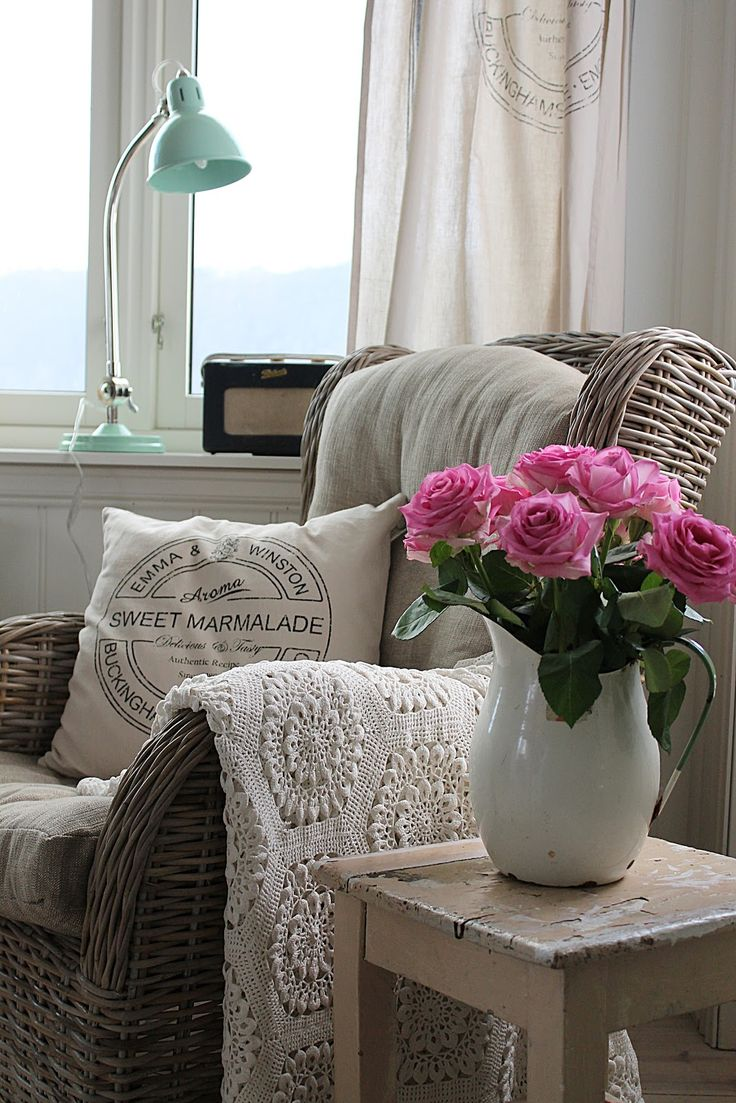 Living Room: Wicker chair, crochet throw, enamel vase