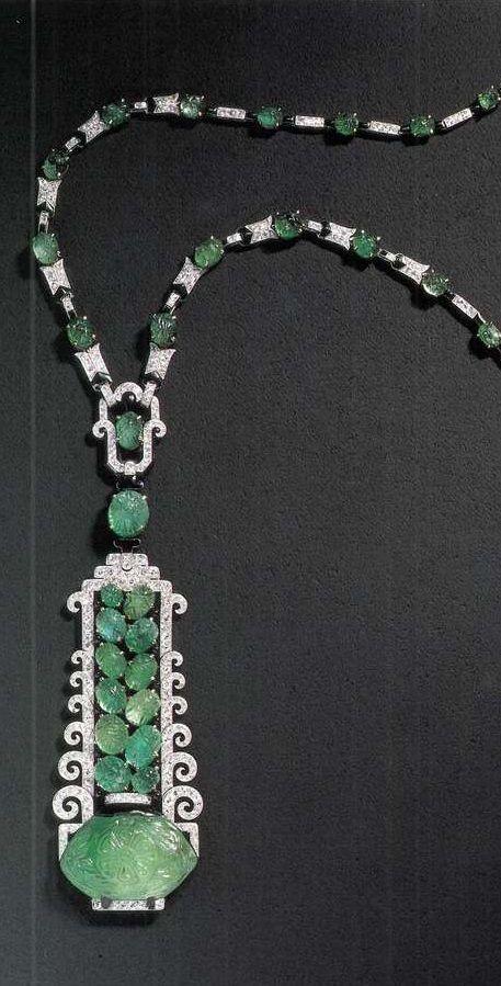 Mauboussin - An Art Deco platinum, enamel, emerald and diamond pendant necklace, circa 1925. The pendant is detachable. Source: Mauboussin - Marguerite de Cerval, 1992. #Mauboussin #ArtDeco #necklace