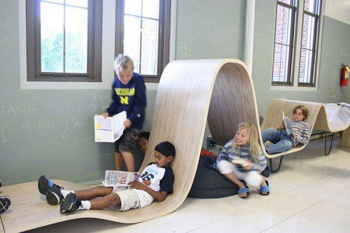 Flying carpet working/reading spaces along hallway