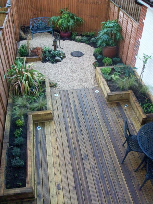 This one is long and narrow but I like the planters ideas, and having the lighting embedded in the decking. Wouldn't use the pebbles, etc. at the end.