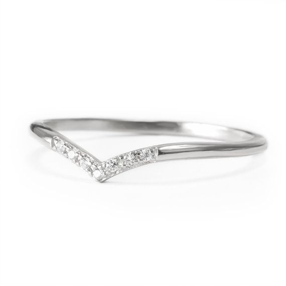 Description: Dainty wedding ring in an elegant curved shape with seven tiny sparkly diamonds. Good simple and elegant design also can be worn