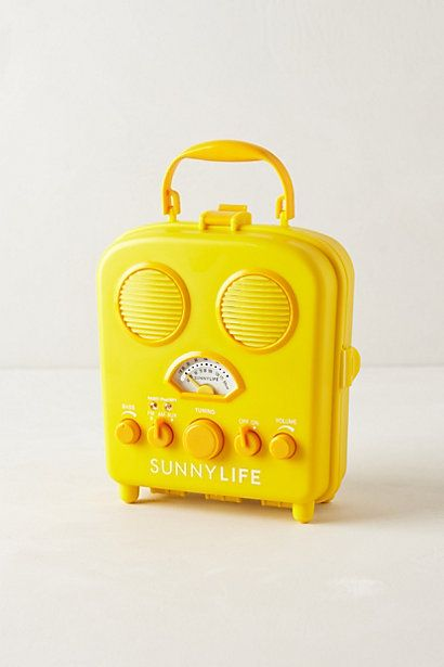 swansea beach radio in bright yellow or red. plug in an iphone/ipod for tunes on the sand.